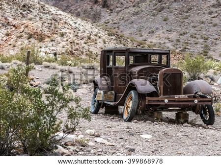 NELSON , USA - JUNE 10 : Rusty old vintage car abandoned in   Nelson Nevada ghost town on June 10 ,2015 - stock photo