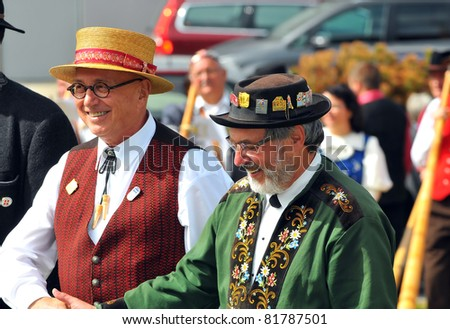 NENDAZ, SWITZERLAND - JULY 24: Finalists Birchler (l) and Bauriedl shake hands at the prize giving ceremony at the 10th International Festival of Alpine horns :  July 24, 2011 in Nendaz Switzerland