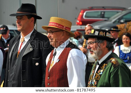 NENDAZ, SWITZERLAND - JULY 24: Prize giving ceremony with Scotton (l), Birchler (c) and  Bauridl  at the 10th International Festival of Alpine horns :  July 24, 2011 in Nendaz Switzerland
