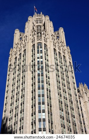 Neo-gothic architecture on Chicago Tribune Building, framed with clear blue sky - stock photo