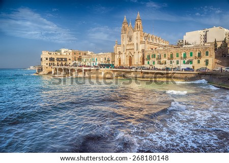 Neo-Gothic church of Our Lady of Mount Carmel (Balluta parish church) at evening under sunlight, situated in Balluta bay, Malta - stock photo