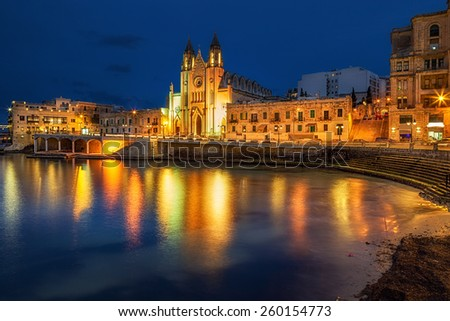 Neo-Gothic church of Our Lady of Mount Carmel (Balluta parish church) at night, situated in Balluta bay, Malta