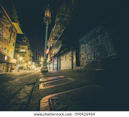 Neo noir style image of Chinatown at night in San Francisco - stock photo
