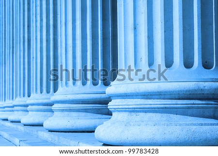 Neoclassical columns of Museum of Fine Arts, Budapest, in business blue - business concept - stock photo