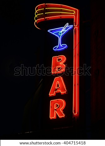 Neon Bar Sign with Cocktail Glass - stock photo