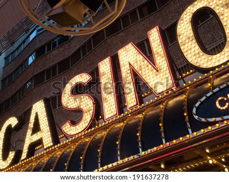 Neon casino sign lit up at night, Las Vegas, Nevada, USA - stock photo