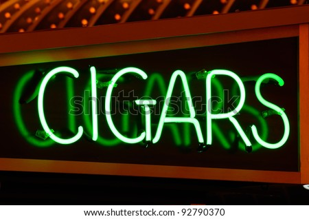 Neon cigar sign on a storefront - stock photo
