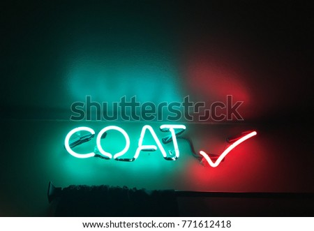 Neon Coat Check Sign In A Dark Entrance To Nightclub Or Theatre