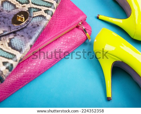 Neon high heels, dress and snakeskin print bag, woman fashion concept - stock photo
