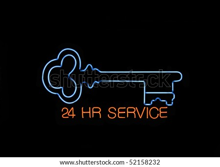 Neon 24 hours Locksmith Sign with a Key - stock photo