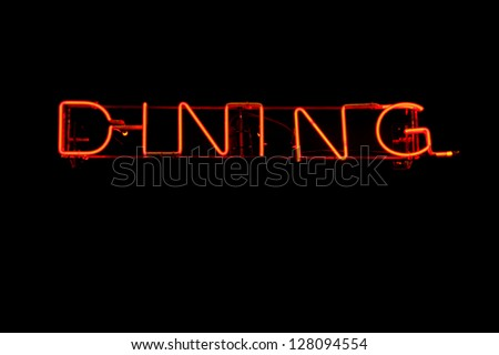 Neon light sign showing the word Dining
