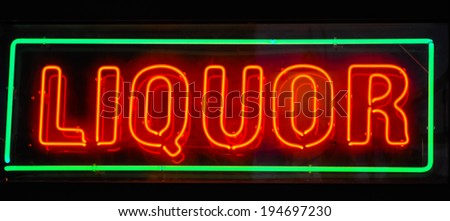 neon liquor sign at a bar - stock photo