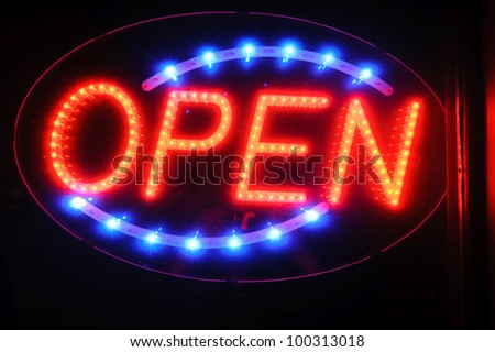 "neon shining signboard with word ""open"" at night - stock photo"
