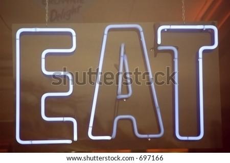 Neon sign in restaurant window - stock photo