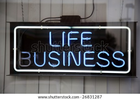 "Neon sign ""life business"""