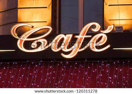 Neon sign of French cafe at christmas time, Paris, France - stock photo