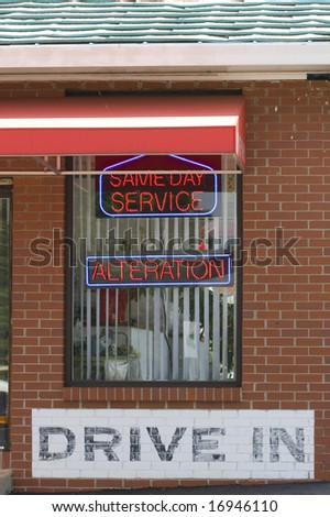 Neon signs on a dry cleaner drive in window - stock photo