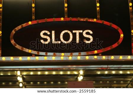 Neon slots sign - stock photo