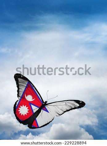 Nepal flag butterfly flying on sky background - stock photo