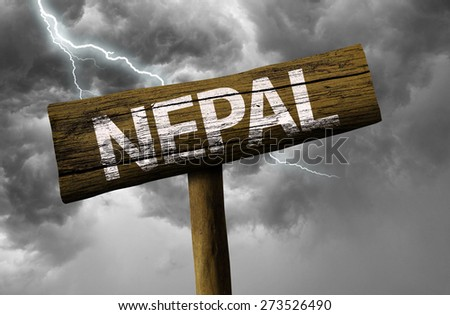 Nepal wooden sign on a bad day - stock photo