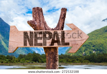 Nepal wooden sign with nature background - stock photo