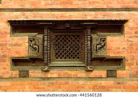 Nepali traditional wooden window and brick wall , visit Nepal, Nepal travel, traditional crafting - stock photo