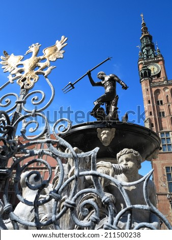 Neptune Fountain and the Main Town Hall in city Gdansk - Poland - stock photo