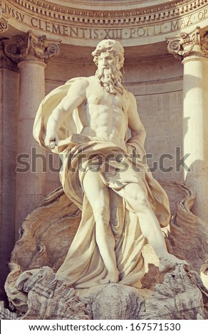 Neptune statue, Trevi Fountain in Rome, Italy. Trevi Fountain in Rome is a Baroque Fountain designed by Nicola Salvi and Pietro Bacci.