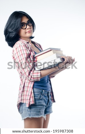 Nerd Asian College Girl With a Pile of Books - stock photo