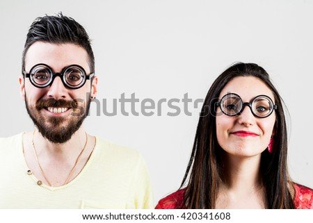 nerd couple made by a nerd man and nerd woman with very thick eyeglasses - stock photo