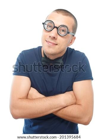 Nerd guy in eyeglasses and bow tie hugging himself - stock photo