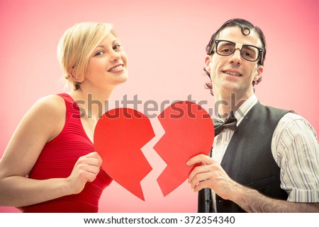 Nerd man boyfriend and girlfriend love portrait with heart for valentine day - stock photo
