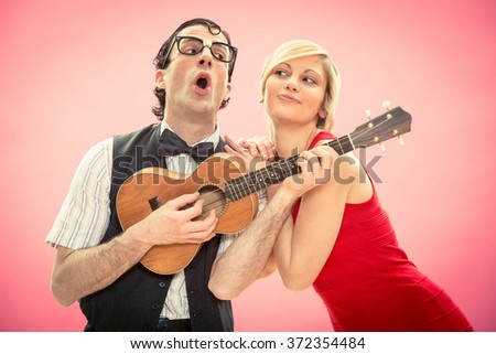 Nerd man boyfriend play ukulele love song for his girlfriend for valentine day