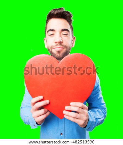 nerd man holding a heart object