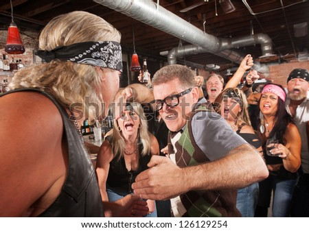Nerd readies a karate chop in fight with gang member - stock photo