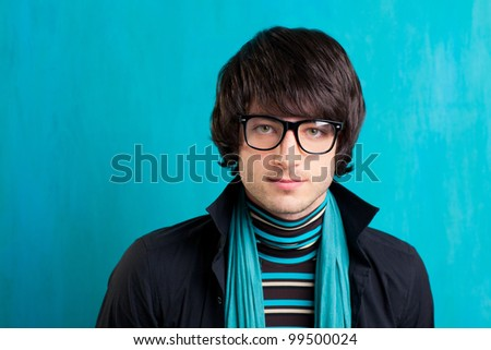 Nerd retro british indie look with handkerchief and vintage glasses - stock photo