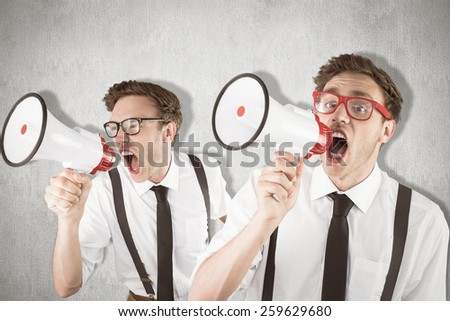 Nerd with megaphone against white and grey background - stock photo