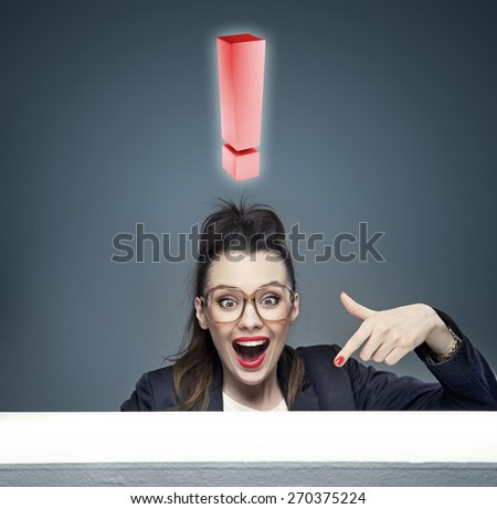 Nerdy businesswoman showing something on the table - stock photo