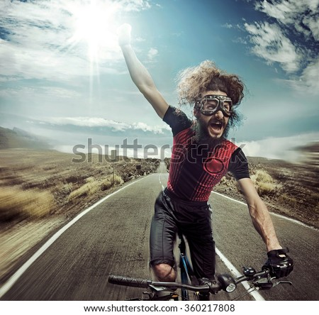 Nerdy cyclist riding on high speed