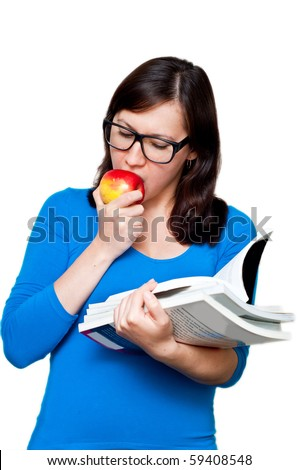 nerdy female with books eating an apple isolated on white background - stock photo