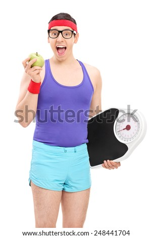 Nerdy guy eating apple and holding a weight scale isolated on white background - stock photo