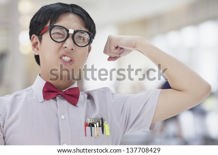 Nerdy Man Flexing His Bicep