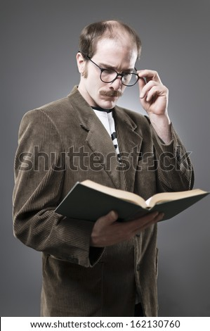 Nerdy Professor Type Reading A Book