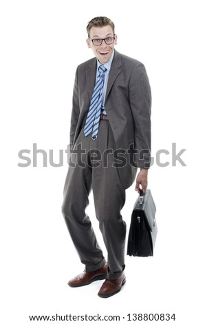 Nerdy salesman with black suitcase and glasses - stock photo