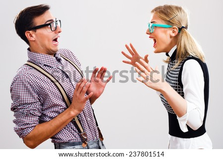 Nerdy woman is shouting at her boyfriend,Nerdy couple having conflict - stock photo