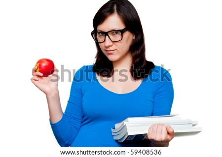 nerdy young female with books and apple isolated - stock photo