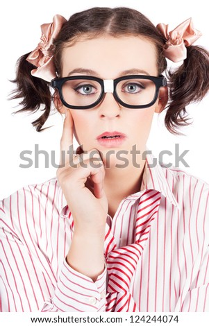 Nerdy Young Woman In Pigtails And Heavy Rimmed Glasses Looking At The Camera With A Look Of Enlightenment As She Suddenly Makes A Mental Breakthrough In A Puzzling Problem - stock photo