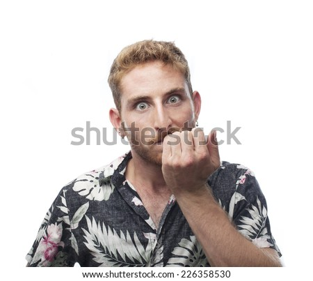 nervious ginger young man biting nails - stock photo