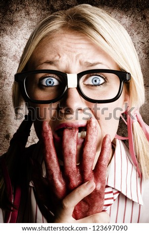 Nervous And Terrified Business Woman Chewing On A Dead Rotten Hard In A Depiction Of A Shock Horror Nail Biter