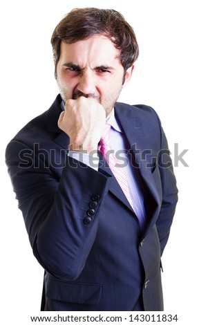 Nervous businessman biting his fist isolated on white. Conceptual image. - stock photo